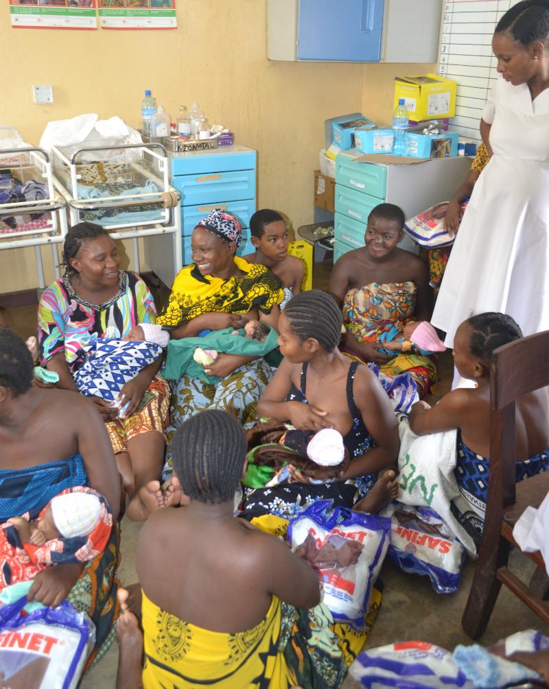 Group of mums feeding babies